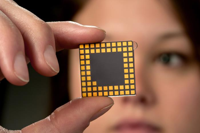 Tech specialist holding computer chip